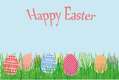 Easter decorative colorful eggs in the grass. Greeting card for the holiday. Free space for text Royalty Free Stock Images