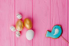 Easter decorative eggs and glazed biscuit. royalty free stock image