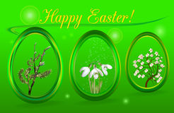 Easter decorative eggs. Easter eggs with snowdrops, flowering tree and willow Royalty Free Stock Photo