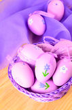 Easter decorative eggs in violet colours Royalty Free Stock Photos