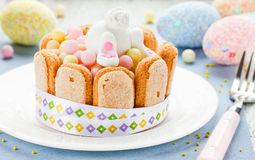 Easter dessert for children: colorful candy treats with cookies Royalty Free Stock Photo