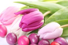 Easter detail. Close-up of candy eggs and tulips stock photo