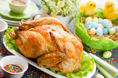 Easter dinner food idea roasted Easter chicken. Easter dinner food idea - roasted Easter chicken on festive Easter table Royalty Free Stock Photo