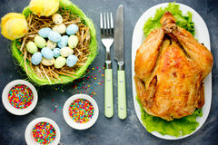 Easter dinner idea - whole roast chicken on Easter table with Ea Royalty Free Stock Photography