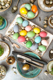 Easter dinner table decoration eggs vibrant Royalty Free Stock Photography