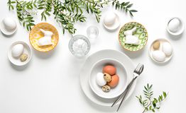 Easter dinner table setting. Home holiday decor concept, view from above, blank space for a text stock photo