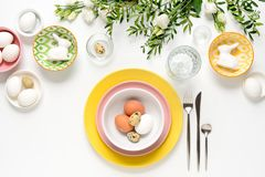 Easter dinner table setting. Home holiday decor concept, view from above stock images