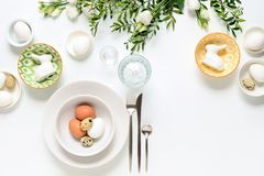 Easter dinner table setting. Home holiday decor concept, view from above, blank space for a text royalty free stock image