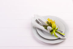 Easter dinner table setting. On white wooden table, festive holiday background top view Stock Photo