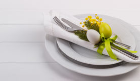 Easter dinner table setting. On white wooden table, festive holiday background top view Stock Images