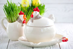 Easter dishes in the form of chickens and rabbits on a white wooden background. Royalty Free Stock Photos