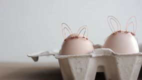 Easter DIY egg, made in bunny style. Minimal Easter concept, idea with rabbit. Craft holiday package, carton box