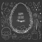 Easter doodles and floral wreath on chalkboard Stock Photos