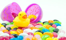 Easter Duck. Yellow rubber duck & easter egg with jelly beans Royalty Free Stock Photo