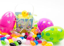 Easter Duck. Yellow rubber duck in easter basket with easter eggs & jelly beans Stock Image