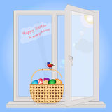 Easter in each house. Basket with Easter eggs is on the window sill. Postcard with Easter greetings. In a basket sitting spring bird. Easter in every home. The Royalty Free Stock Photo