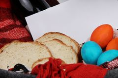 Easter. Easter table. ester composition with easter eggs, vine, bread and envelope with text. royalty free stock photography