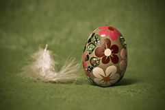 Easter egg. Easter composition; egg and feather Stock Image