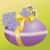 Easter egg. With ribbon and flowers Royalty Free Stock Images