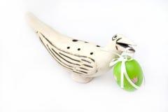 Easter egg. Painted green Easter Egg in a bird's beak Royalty Free Stock Image