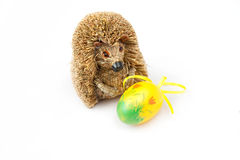 Easter egg. Painted yellow Easter Egg with hedgehog on a white background Royalty Free Stock Photo