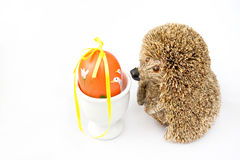 Easter egg. Painted orange Easter Egg with hedgehog on a white background Royalty Free Stock Images
