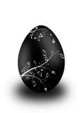 Easter egg. Black easter egg with white floral ornaments stock illustration