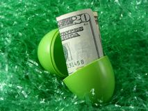 Easter egg. Green Easter egg and cash Royalty Free Stock Photography