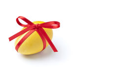 Easter Egg. Yellow Easter Egg with red ribbon Royalty Free Stock Photos
