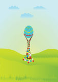 Easter egg. Festive Easter illustration. A large Easter egg, which grows on trees and green sunny meadow royalty free illustration