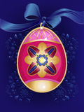 Easter egg. Beautiful decorated Easter egg on blue background Stock Image
