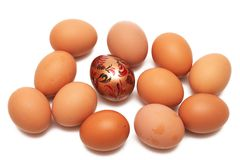 Easter egg. One colored egg among ordinary ones Royalty Free Stock Photography