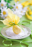 Easter egg. Chocolate Easter egg wrapped with yellow paper, selective focus Stock Image