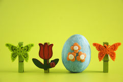 Easter egg. Decorated with flowers on a green  background Stock Images