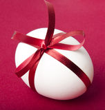 Easter egg. On a red background Royalty Free Stock Photo