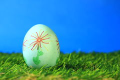Easter egg. Easter decoration from single, brightly painted, Easter egg in green artificial turf Stock Photos