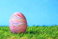 Easter egg. Colorful painted Easter egg in green grass Stock Images