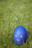 Easter egg. Dyed Domestic Easter egg, on the grass Stock Image