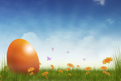 Easter egg. Festive easter egg background with big egg on flowery meadow and butterflies around Stock Photo