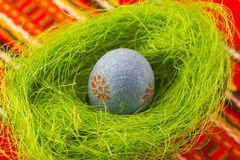 Easter egg. Colored Easter egg in small basket with grass Stock Photo