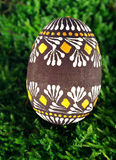 Easter Egg. Hand painted Easter Egg with pagan ornaments on Moss Stock Image