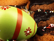 Easter egg andMuffins with chocolate icing. Royalty Free Stock Images