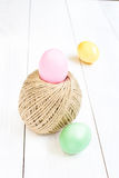 Easter egg and ball rope on wooden background Stock Photos