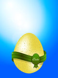 Easter egg with banner on blue sky background Royalty Free Stock Images