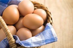 Easter egg in a basket Stock Photos
