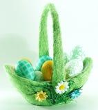 Easter egg basket. Green easter egg basket with nice decorative eggs Royalty Free Stock Image