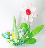Easter egg basket. Easter seasonal basket with eggs and flower Royalty Free Stock Image