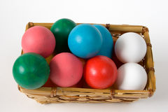 Easter Egg Basket. Easter Basket with Real & Toy Colored Eggs; on white Stock Photography