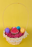 Easter egg basket with cupcake Stock Photos