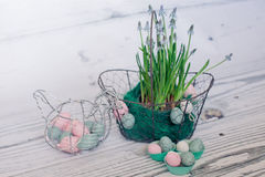 Easter egg in basket with flowers Stock Photo
